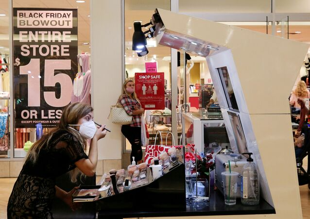 An employee wearing a protective mask applies makeup at Coastal Grand Mall on Black Friday, as the coronavirus disease (COVID-19) pandemic continues, in Myrtle Beach, South Carolina, U.S., November 27, 2020
