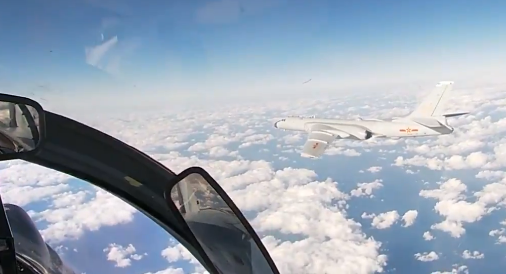 Fighter escorting Chinese Air Force bomber during joint Russian-Chinese patrol in the Asia-Pacific Region, Tuesday, 22 December 2020.
