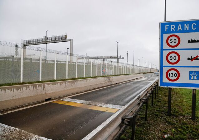 An empty road where lorries from Britain usually leave the Eurotunnel terminal to join the highway in Coquelles near Calais, northern France, after France barred all traffic from the United Kingdom, for 48 hours from Sunday night, over fears of a new strain of the coronavirus, amid the spread of the coronavirus disease (COVID-19) in France, 22 December 2020.