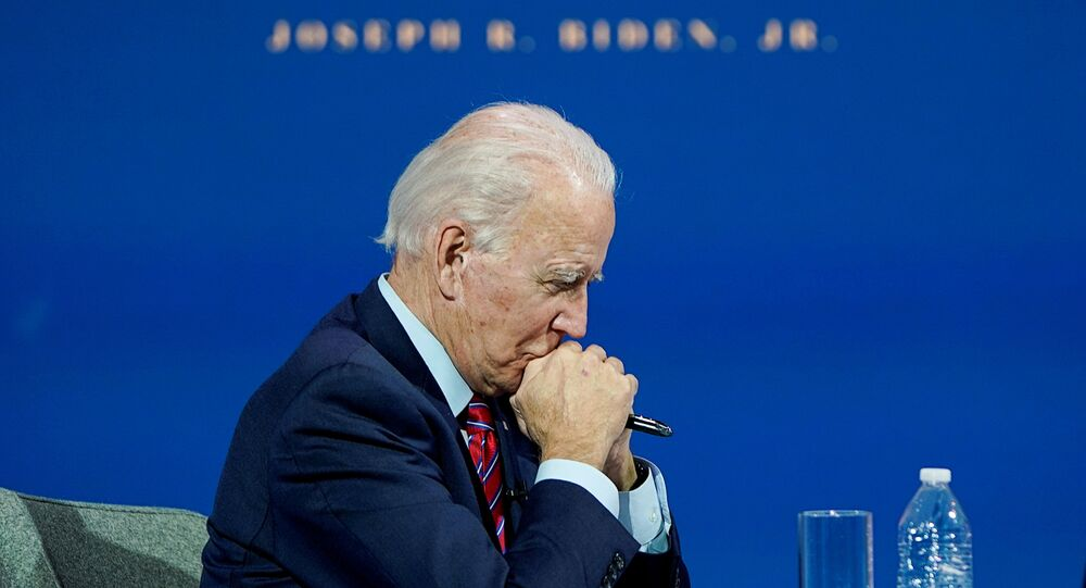 U.S. President-elect Joe Biden listens as he holds a videoconference meeting with members of the U.S Conference of Mayors at his transition headquarters in Wilmington, Delaware, U.S., November 23, 2020.