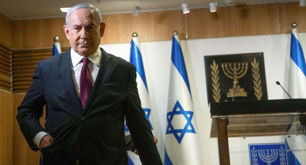 Israeli Prime Minister Benjamin Netanyahu walks after he delivered a statement at the Knesset (Israel's parliament) in Jerusalem, December 22, 2020