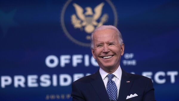 U.S. President-elect Joe Biden reacts as he answers questions from the news media after speaking about the recent massive cyber attack against the U.S. and also other Biden administration goals in Wilmington, Delaware, U.S., December 22, 2020 - Sputnik International