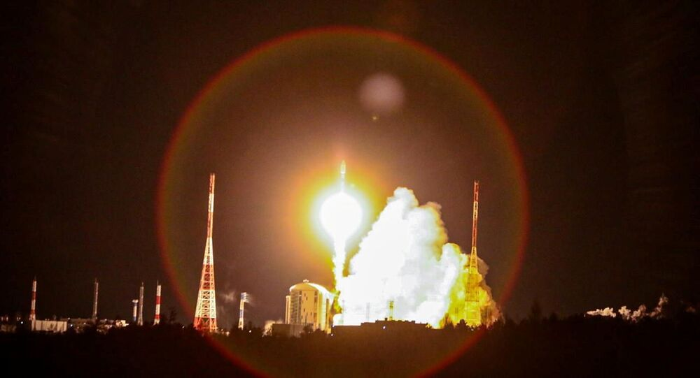 A Soyuz-2.1b rocket booster carrying the satellites of British firm OneWeb blasts off from a launch pad at the Vostochny Cosmodrome in Amur Region, Russia December 18, 2020.