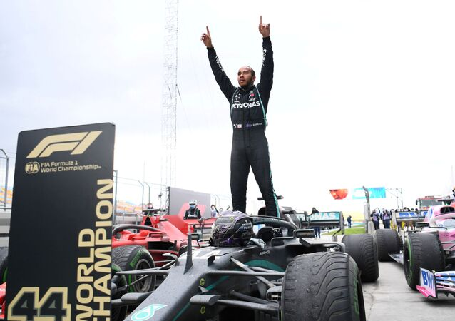 Formula One F1 - Turkish Grand Prix - Istanbul Park, Istanbul, Turkey - 15 November 2020 Mercedes' Lewis Hamilton celebrates after winning the race and the world championship