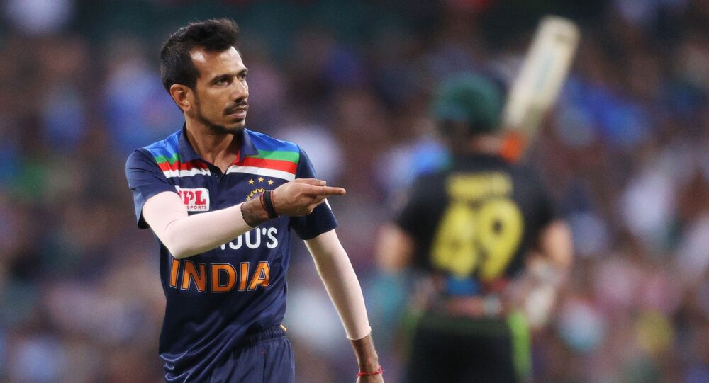 Cricket - Third Twenty20 International - Australia v India - Sydney Cricket Ground, Sydney, Australia - December 8, 2020 India's Yuzvendra Chahal reacts