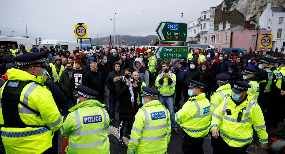 Drivers stand in front of police officers as they block the exit at the Port of Dover, as EU countries impose a travel ban from the UK following the coronavirus disease (COVID-19) outbreak, in Dover, Britain, December 23, 2020