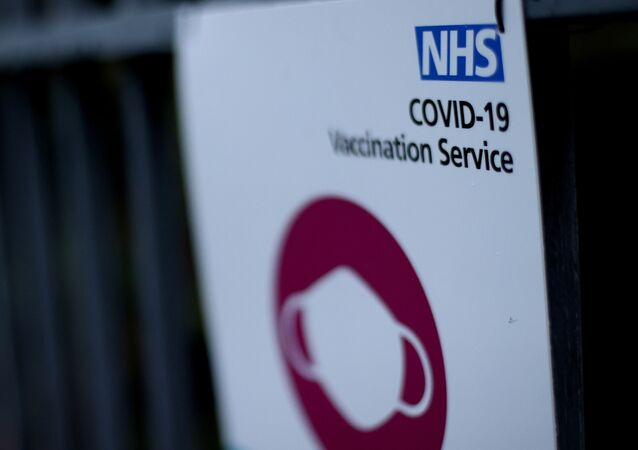 A sign is seen outside a surgery in Wolverhampton, Britain  that is delivering the Pfizer-BioNTech COVID-19 vaccine, 14 December 2020