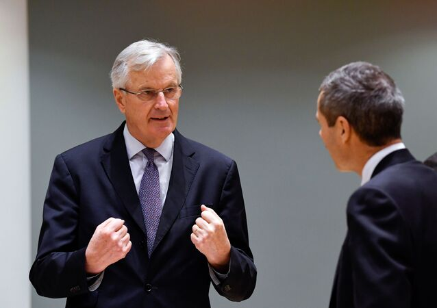 European Union's chief Brexit negotiator Michel Barnier gestures as he speaks with Ambassador Michael Clauss, Permanent Representative of Germany to the EU, during a meeting of the Committee of the Permanent Representatives of the Governments of the Member States to the European Union (COREPER) in Brussels, Belgium December 22, 2020.