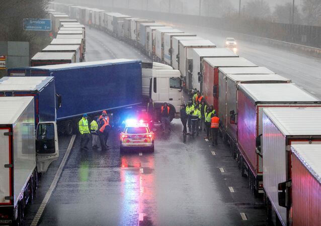 A lorry blocks M20 motorway where trucks queue to port Dover, as EU countries impose a travel ban from the UK following the coronavirus disease (COVID-19) outbreak, near Ashford, Britain, December 23, 2020.