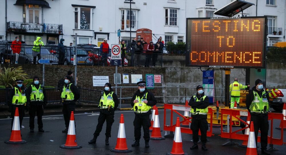 Police officers stand at the entrance to the Port of Dover, amid the coronavirus disease (COVID-19) outbreak
