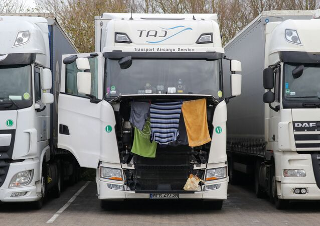 Clothes and towels hang to dry on a lorry at Ashford International Truck Stop, as EU countries impose a travel ban from the UK after the coronavirus disease (COVID-19) outbreak, in Ashford, Britain
