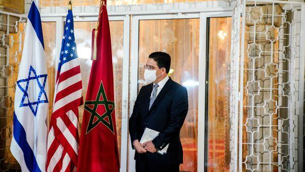 Moroccan Foreign Minister Nasser Bourita looks on during a visit by Israeli envoys to Rabat, Morocco, December 22, 2020. Picture taken December 22, 2020.  - Sputnik International