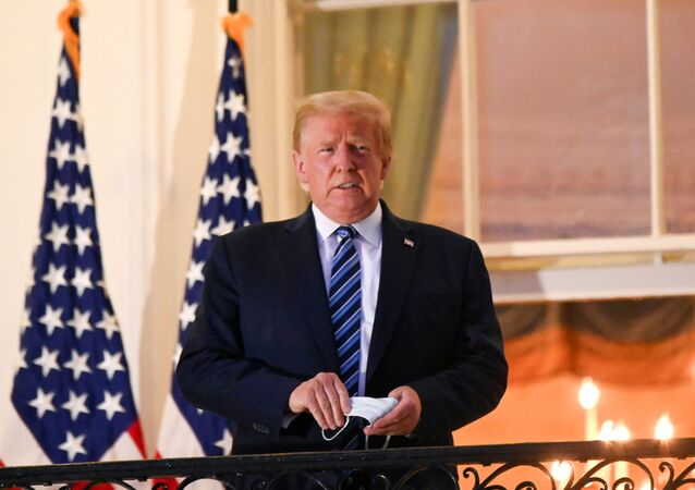 US President Donald Trump poses on the Truman Balcony of the White House after returning from being hospitalized at Walter Reed Medical Center for coronavirus disease (COVID-19) treatment, in Washington, U.S. October 5, 2020