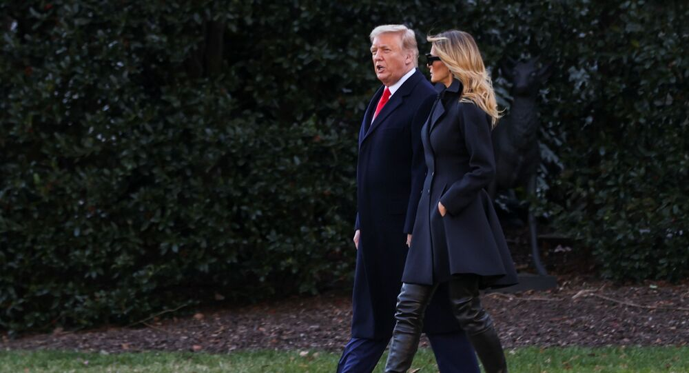 US President Donald Trump, accompanied by first lady Melania Trump, departs from the White House for holiday travel to his home in Florida, in Washington, US, 23 December 2020.