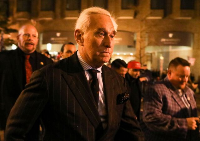 Roger Stone, a longtime friend and adviser of U.S. President Donald Trump, walks as supporters of Trump and members of the Proud Boys march the night before rallies to protest the US presidential election results, in Washington, DC, 11 December 2020