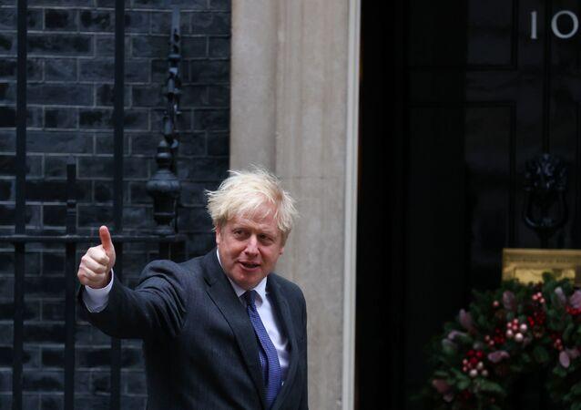 British Prime Minister Boris Johnson gives the thumbs-up.