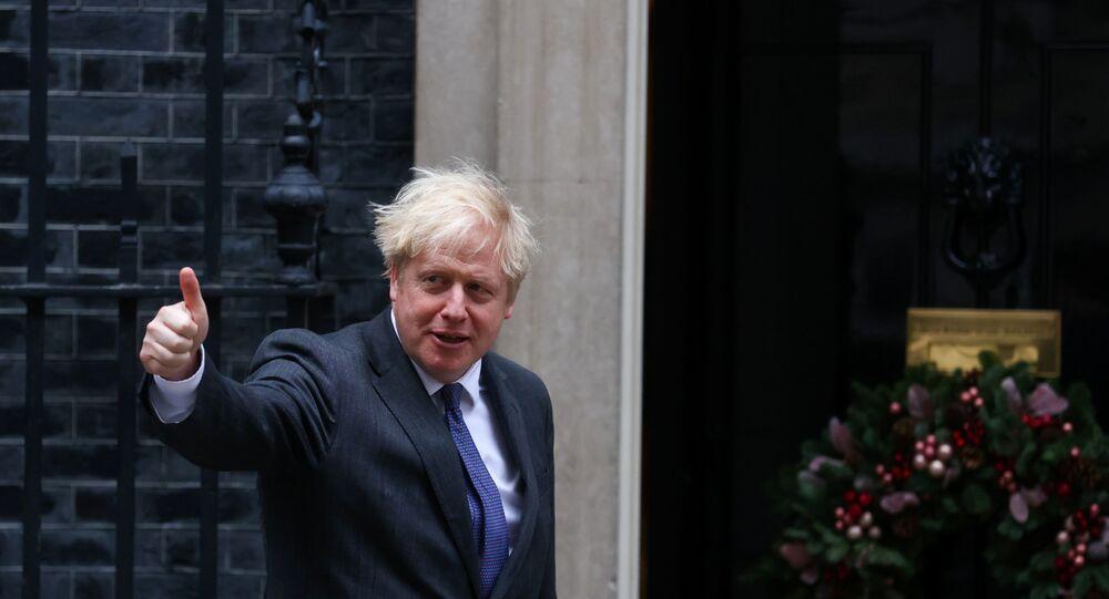 British Prime Minister Boris Johnson gestures