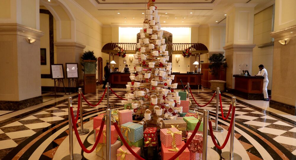 A Christmas tree is decorated with face masks inside a hotel lobby to create awareness about wearing a mask during the coronavirus disease (COVID-19) outbreak, ahead of Christmas celebrations, in Mumbai