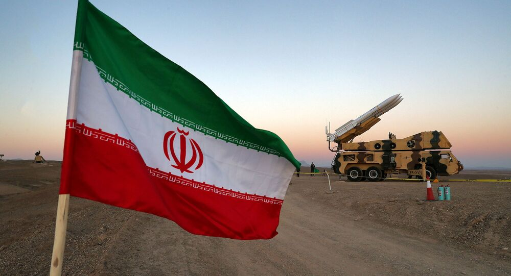 An Iranian flag is pictured near in a missile during a military drill, with the participation of Iran's Air Defense units, Iran October 19, 2020.