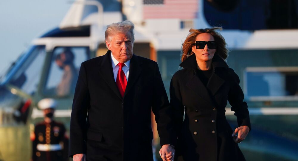 U.S. President Donald Trump and first lady Melania Trump prepare to board Air Force One at Joint Base Andrews in Maryland, U.S., December 23, 2020.