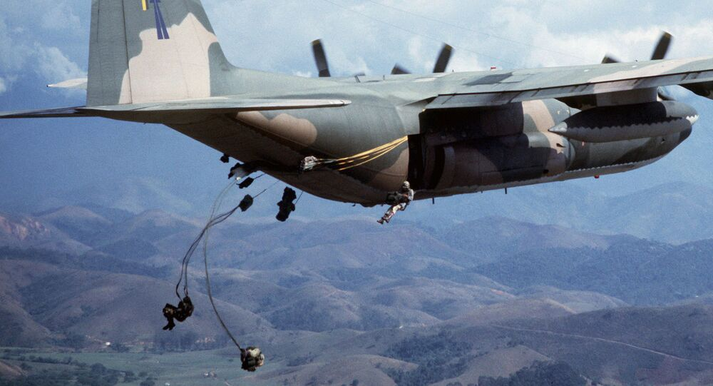 Brazilian paratroopers jump from a 50th Tactical Airlift Squadron C-130E Hercules aircraft