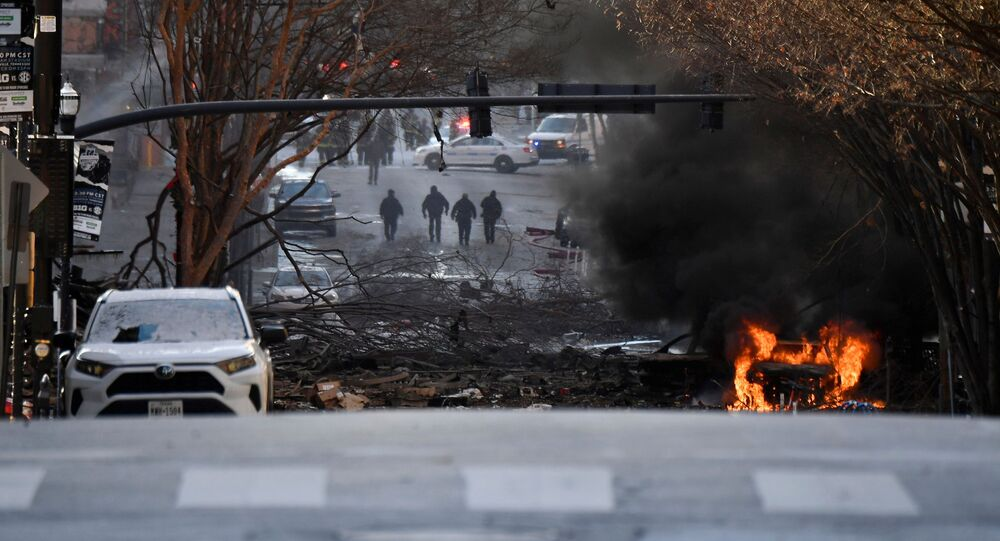 A vehicle burns near the site of an explosion in the area of Second and Commerce in Nashville, Tennessee, U.S. December 25, 2020. Andrew Nelles/Tennessean.com/USA TODAY NETWORK via REUTERS.