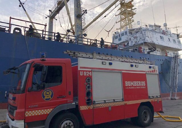 A photo of the Canarian fire engine near the Russian fishing vessel Sveaborg after the fire occured on it, December 25, 2020