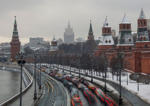 Cars drive along the embankment of Moskva river by towers of the Kremlin in Moscow, Russia November 23, 2020.
