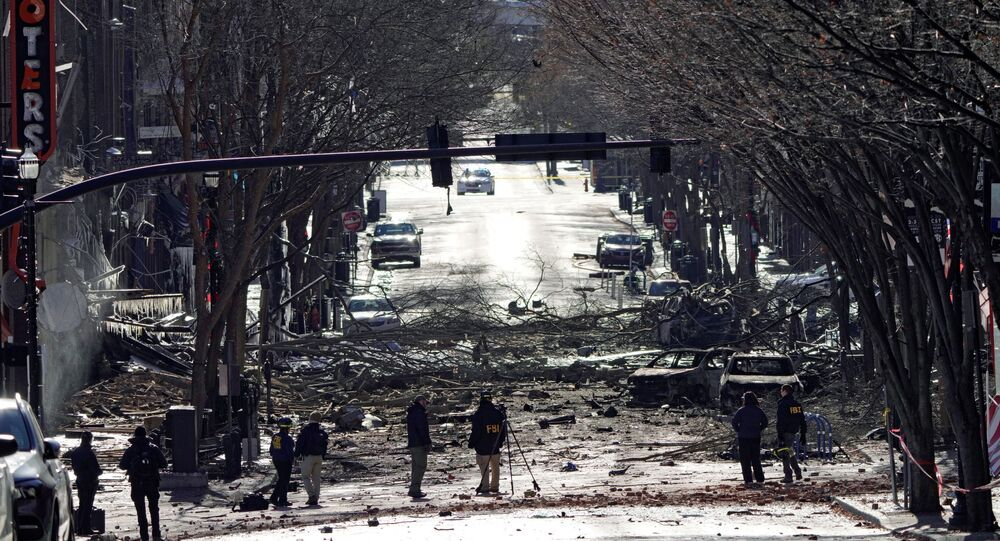 Investigators work near the site of an explosion on 2nd Avenue that occurred the day before in Nashville, Tennessee, U.S. December 26, 2020.