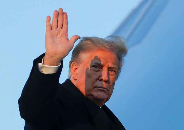 U.S. President Donald Trump waves as he boards Air Force One at Joint Base Andrews in Maryland, U.S., December 23, 2020.