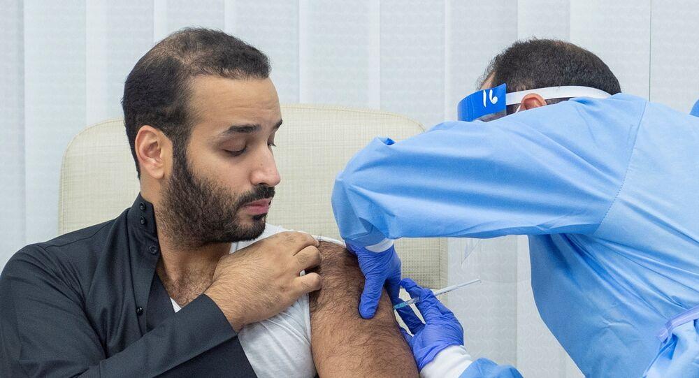 Saudi Crown Prince Mohammed bin Salman gets a dose of a coronavirus disease (COVID-19) vaccine in Riyadh, Saudi Arabia, December 25, 2020.