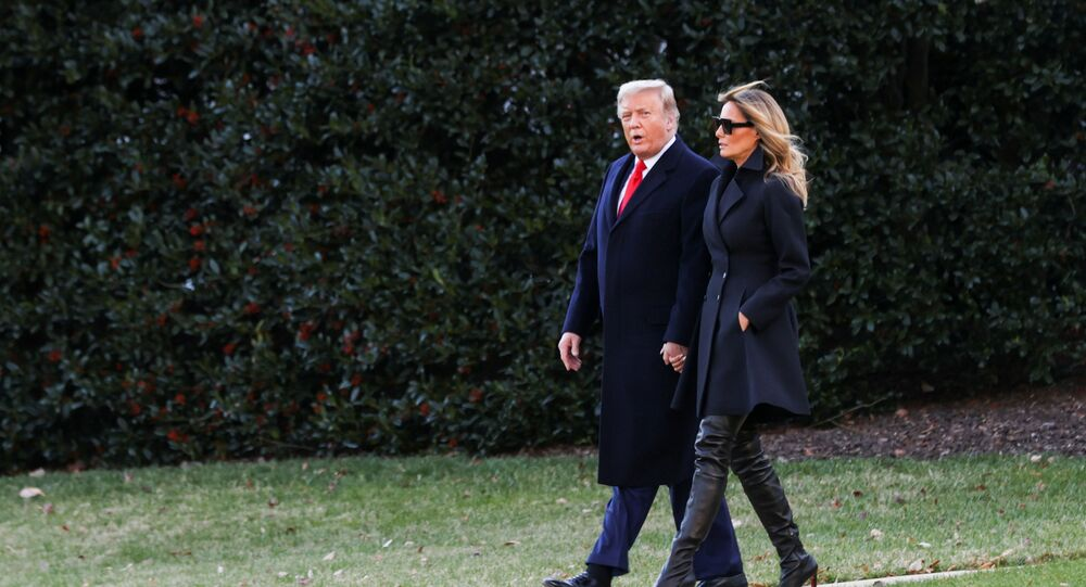 U.S. President Donald Trump, accompanied by first lady Melania Trump, departs from the White House for holiday travel to his home in Florida, in Washington, U.S., December 23, 2020.