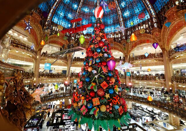 A giant Christmas tree stands at the Galeries Lafayette department store where lights were switched on for the festive season in Paris, France, November 30, 2020.