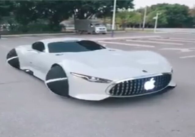 Screenshot from video showing CGI-rendered car with Apple logo on the grill