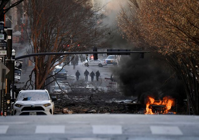 A vehicle burns near the site of an explosion in the area of Second and Commerce in Nashville, Tennessee, U.S. December 25, 2020.