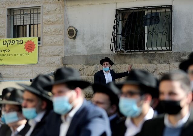 Ultra Orthodox Jews attend a mass funeral for Rabbi Aharon David Hadash, the spiritual leader of Jerusalem's Mir Yeshiva, one of the largest Jewish seminary in Israel, amid the coronavirus disease (COVID-19) restrictions in Jerusalem December 3, 2020.