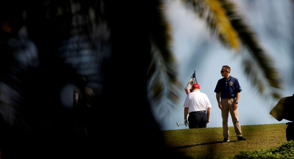 U.S. President Donald Trump plays golf at the Trump International Golf Club in West Palm Beach, Florida, U.S., December 27, 2020.