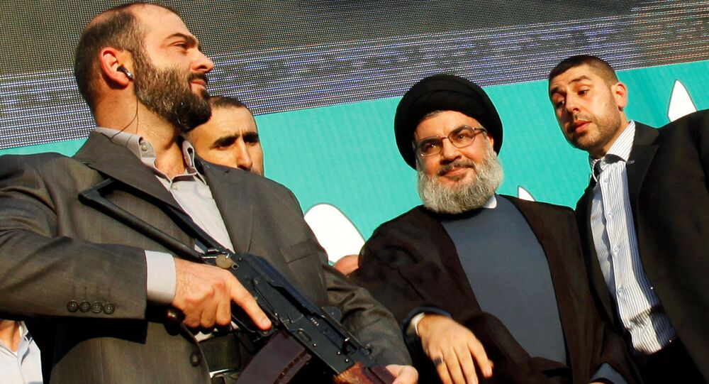 Lebanon's Hezbollah leader Sayyed Hassan Nasrallah (2nd R), escorted by his bodyguards, greets his supporters at an anti-U.S. protest in Beirut's southern suburbs, Lebanon September 17, 2012.