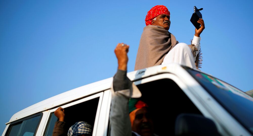 India's Modi calls farmer protests over contested laws politically motivated