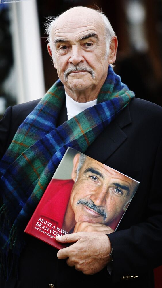Scottish screen legend Sir Sean Connery poses for photographers as he promotes his new book 'Being a Scot' at the Edinburgh International Book Festival, in Charlotte Square gardens in Edinburgh, 25 August 2008.