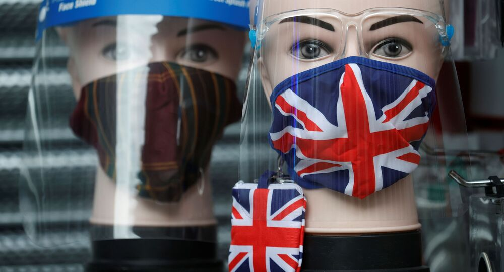 A Union Jack design face mask is seen for sale in the window of a shop amid the outbreak of the coronavirus disease (COVID-19) in Manchester, Britain, December 26, 2020