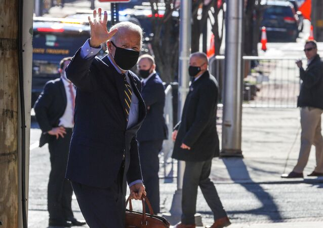 U.S. President-elect Joe Biden waves as he arrives at his transition headquarters in Wilmington, Delaware, U.S., December 28, 2020.