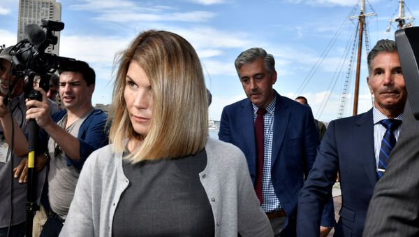 FILE PHOTO: Actress Lori Loughlin, and her husband, fashion designer Mossimo Giannulli leave the federal courthouse after a hearing on charges in a nationwide college admissions cheating scheme in Boston, Massachusetts, U.S., August 27, 2019.  REUTERS/Josh Reynolds/File Photo - Sputnik International