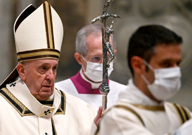 Pope Francis arrives for a Mass on Christmas Eve  in St. Peter's Basilica amid the coronavirus disease (COVID-19) pandemic at the Vatican December 24, 2020.