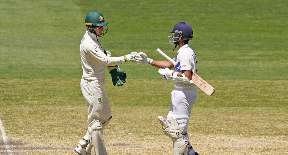 Tim Paine of Australia congratulates India's Ajinkya Rahane after India won the match during day four of the second test match between Australia and India at The MCG, Melbourne, Australia, December 29, 2020.