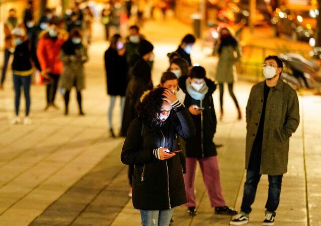 People queue to get tested amid the coronavirus disease ( COVID-19) pandemic in Madrid, Spain, December 21, 2020