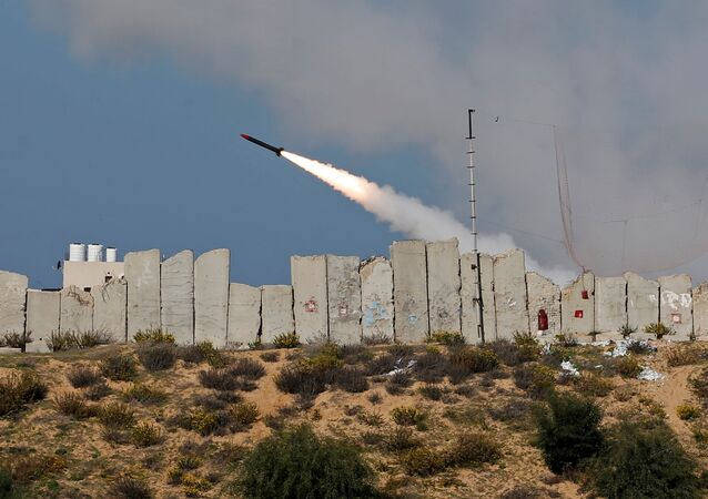 A rocket is launched by Palestinian militant groups into the Mediterranean Sea off the Gaza Strip at the start of their first-ever joint exercise, in Gaza City December 29, 2020
