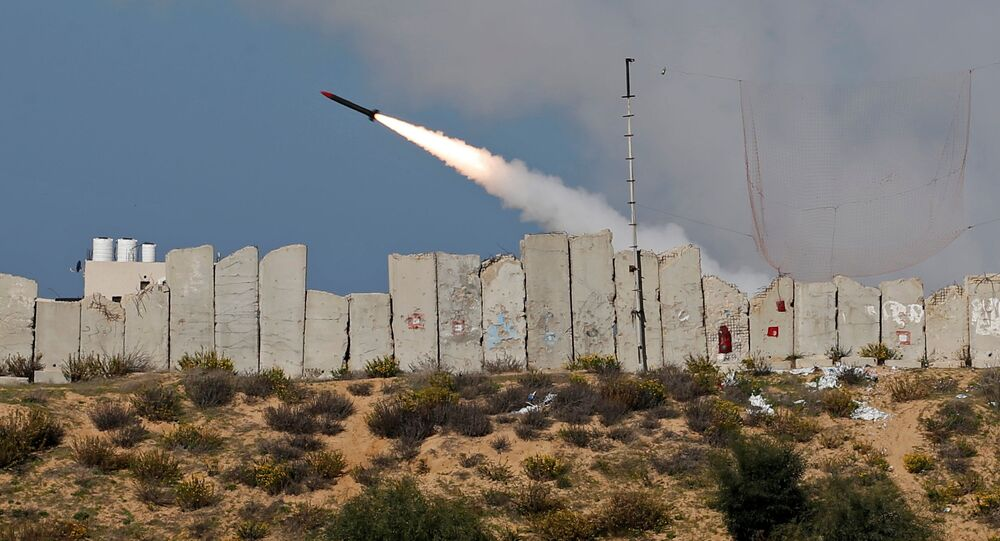 A rocket is launched by Palestinian militant groups into the Mediterranean Sea off the Gaza Strip at the start of their first-ever joint exercise, in Gaza City, 29 December 2020