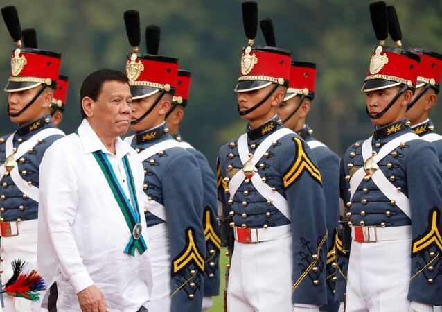 Philippines President Rodrigo Duterte reviews military cadets during change of command ceremonies of the Armed Forces of the Philippines (AFP) at Camp Aguinaldo in Quezon City, metro Manila, Philippines 26 October 2017.