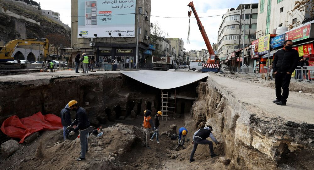 Archaeologists and workers excavate at a Roman archaeological site discovered during works to install a water drainage system, in downtown Amman, Jordan, December 27, 2020.